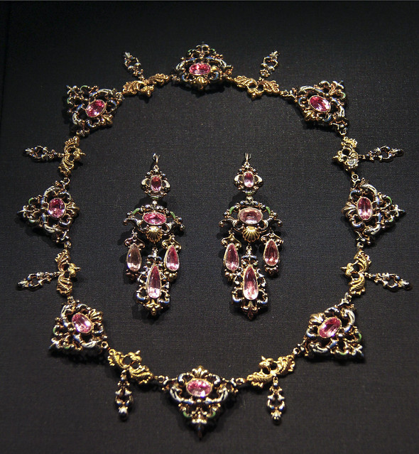 Parure (set of necklace, pendant brooch and earrings), Possibly Switzerland, about 1835-40, Stamped and enamelled gold, set with pink foiled topaz
