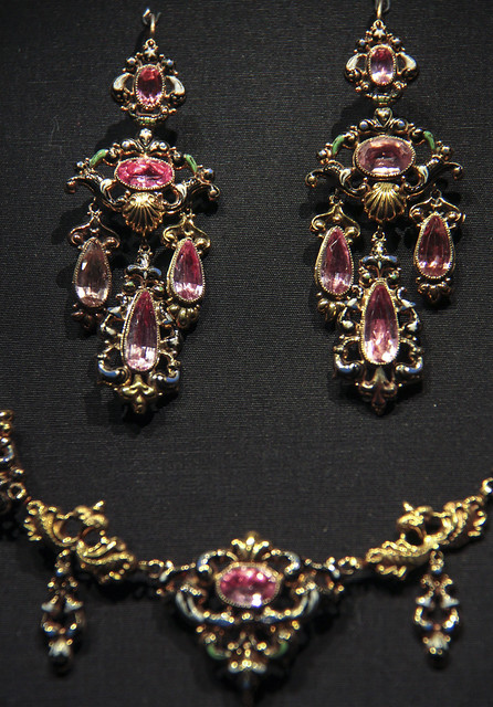 Detail-  Parure (set of necklace, pendant brooch and earrings), Possibly Switzerland, about 1835-40, Stamped and enamelled gold, set with pink foiled topaz
