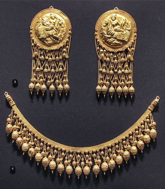 Pair of pendants with a nereid on a sea horse, Italy, 1864-76, made by Castellani, Gold, chased with granulation and filigree. Made after Greek originals about 330-300BC