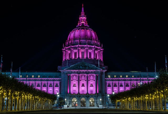 city hall illuminated in pink for breast cancer awareness month