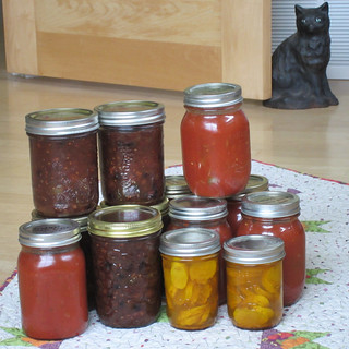 Green tomato mincemeat, red tomato sauce, yellow zucchini pickles