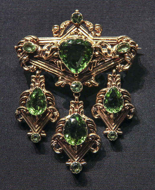 Brooch, England, about 1835, stamped gold, set with peridots
