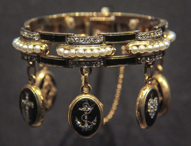Bracelet in the Moroccan manner, France, about 1860, perhaps made by the Parisian jeweller Crouzet, gold, enamelled in black, set with pearls and brilliant-cut diamonds