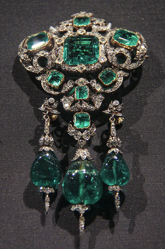 Large brooch, England, the setting probably 1874-87, Emeralds and brilliant-cut diamonds set in gold and silver