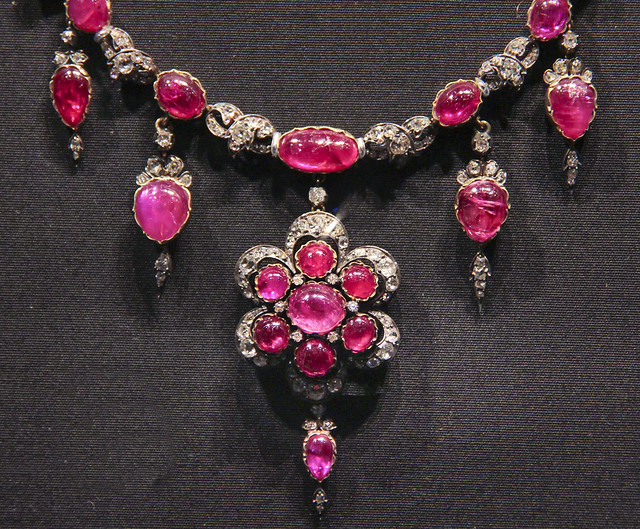 Detail - Necklace, England probably 1874-87, Cabochon-cut rubies and brilliant-cut diamonds set in gold and silver