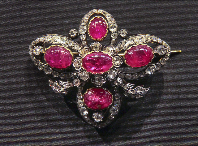 Brooch, England, probably 1874-87, Cabochon-cut rubies and brilliant-cut diamonds set in gold and silver