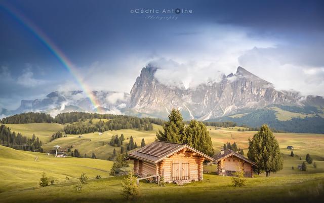 Rainbow over the huts of Alpe di Siusi