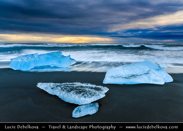 Iceland - Jökulsárlón Glacier Lagoon - Black Sand beach with Pieces of Ice @ Sunrise