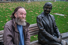 Mr Bean and a homeless guy share a bench in London's Leicester Square