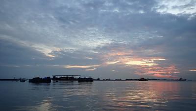 Sunset over fish farm off Pulau Semakau