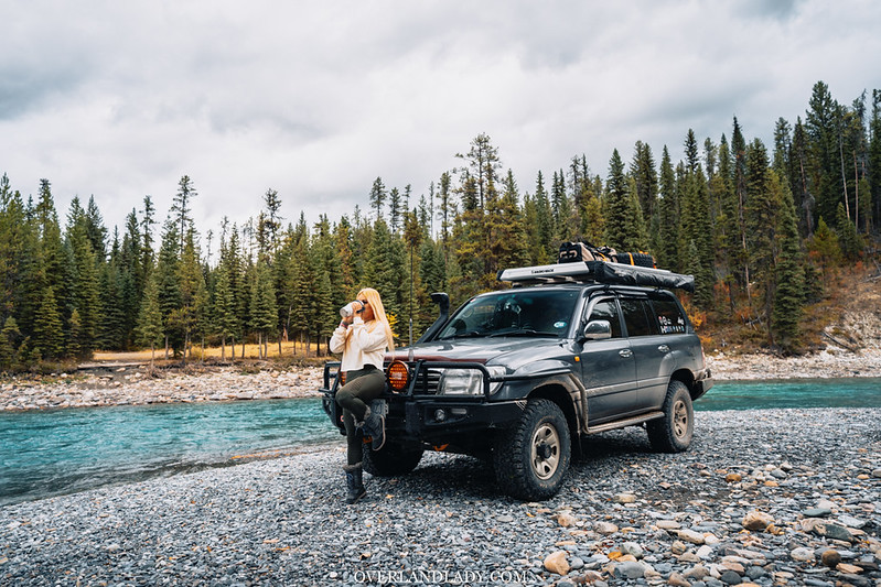 Toyota Landcruiser 100 series in the rockies blue water. overland lady travel solo