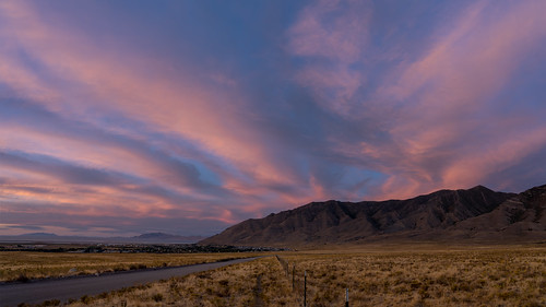 tooele utah unitedstates sunset pink clouds fence mountains lakepoint dirtroad