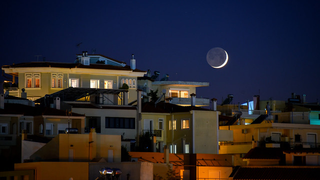 moonset over Alimos roofs