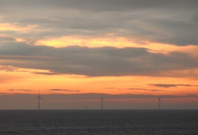 Offshore Wind Turbine Trio at Dawn