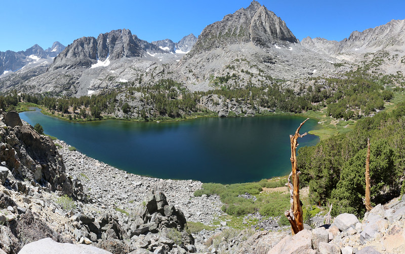 Panorama view of Sixth Lake from the high perch to its north, with Two Eagle Peak right of center
