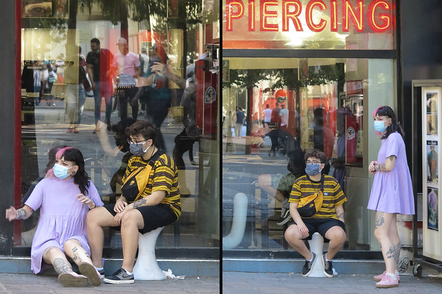 Young couple in front of a piercing shop in accordance with anti coronavirus rules