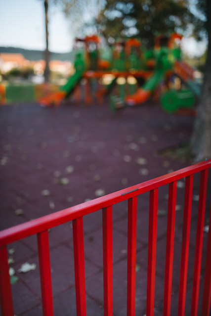 Red fence on playground