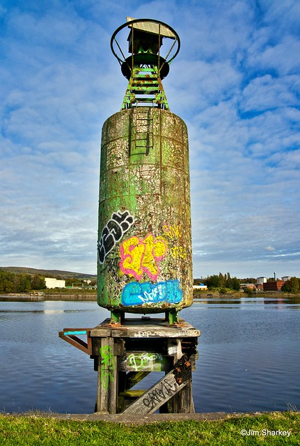 graffitied channel marker on the Clyde