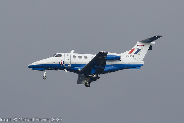 ZM335 - 2017 build Embraer 500 Phenom 100, performing a training approach to Runway 23R at Manchester