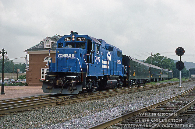 GP38-2 7977 leads a passenger special at Northumberland, PA on  8/14/84.