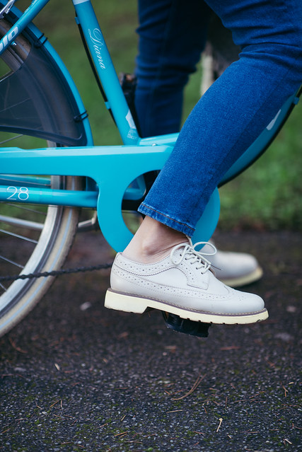 Close up of a womans feet on the bicycle pedal.