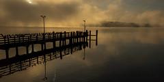Early morning in late october sunrise lake Starnberg, small pier