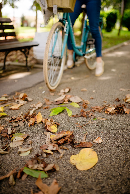 Woman riding a bicycle in a park.