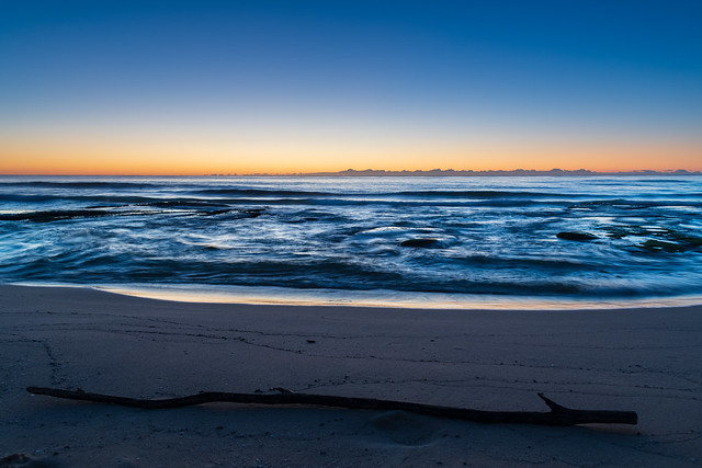 Clear skies and small waves, dawn at the beach