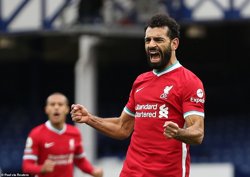 Mohamed Salah celebrates after restoring Liverpool's lead with 18 minutes of the game left but it didn't prove enough