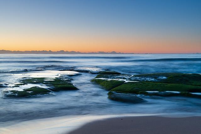 Clear skies and soft seas, dawn at the beach