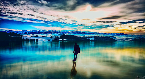 ice skating skater eislaufen eis patinage berneseoberland lake reflection sunset sunrise bern switzerland rx100m3 rx100iii lewelsch lewelschphoto swissphotographers