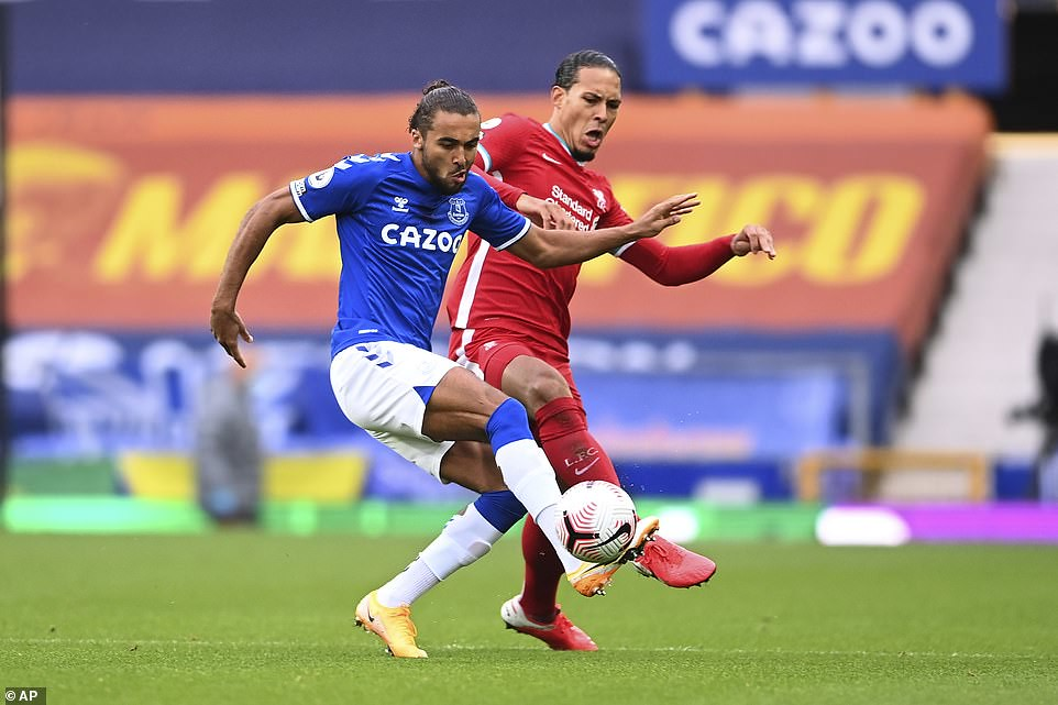 Everton's in-form striker competes for the ball with Van Dijk during the first half at Goodison Park on Saturday afternoon