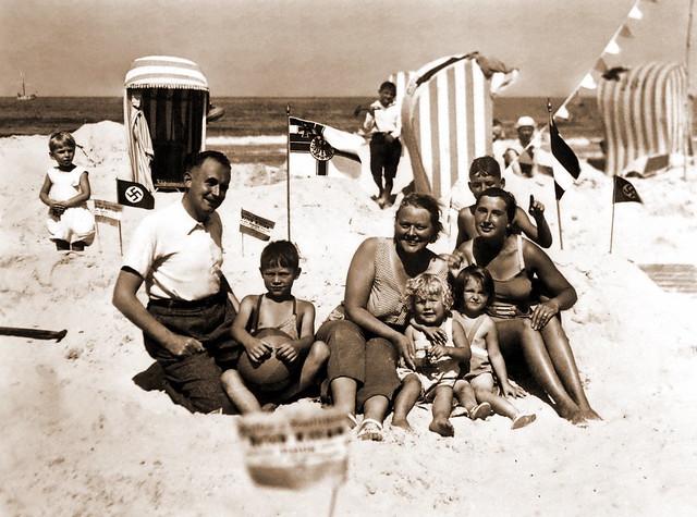 Summer family fun at the beach on the Baltic Sea in Kolberg, Germany (now Kołobrzeg, Poland) circa 1933
