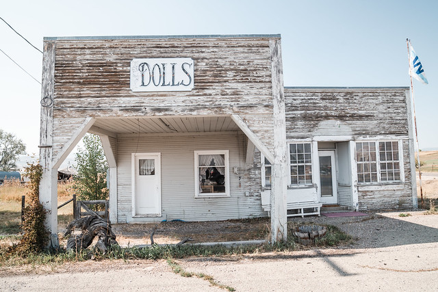 Ovid, Idaho - September 20, 2020: Old, creepy abandoned Dolls store building, on a sunny day