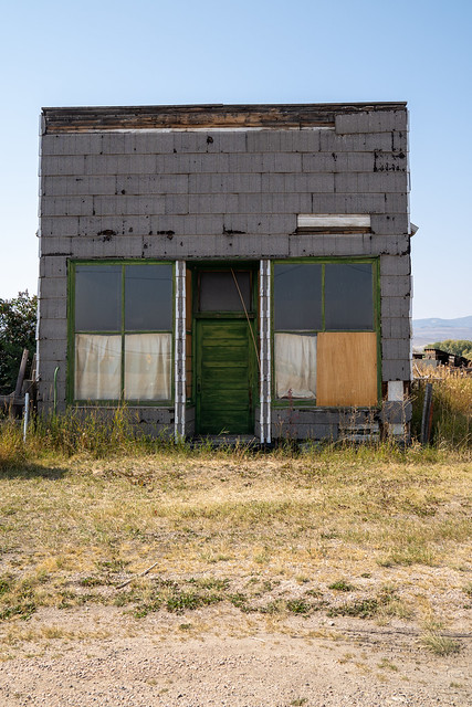 Old abandoned building in rural Ovid, Idaho on a sunny day