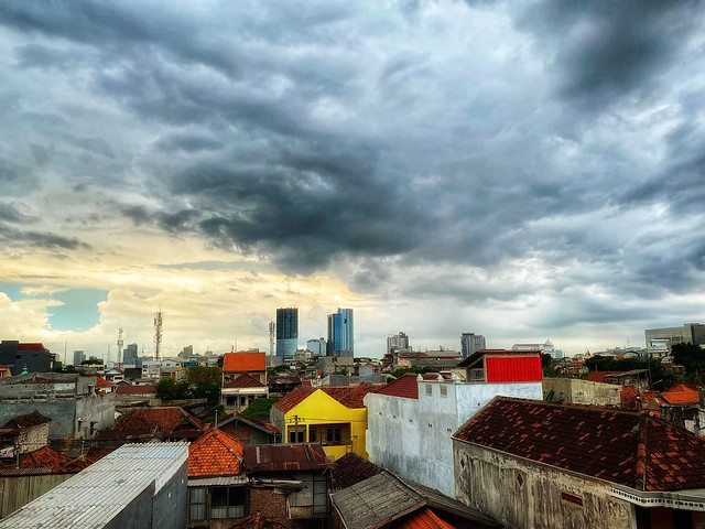Thick clouds hovering over Surabaya city