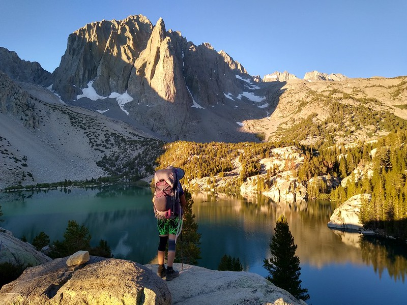 Cell phone camera shot of Vicki and her backpack in front of Temple Crag and Second Lake