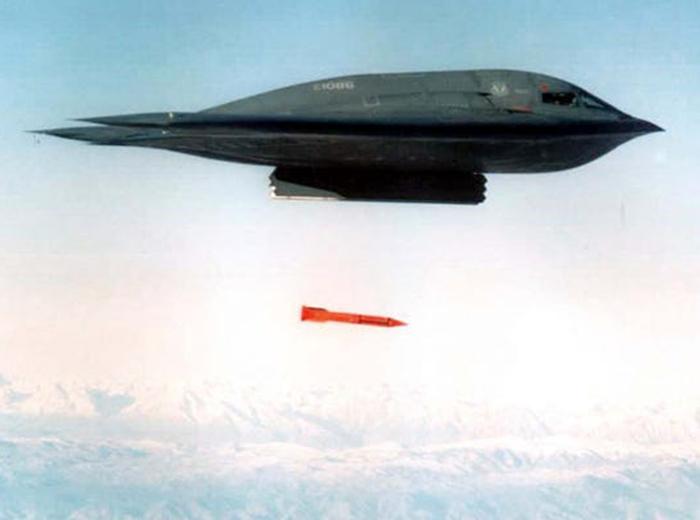 A B-2 Spirit stealth bomber drops a mock-B61 gravity bomb.
