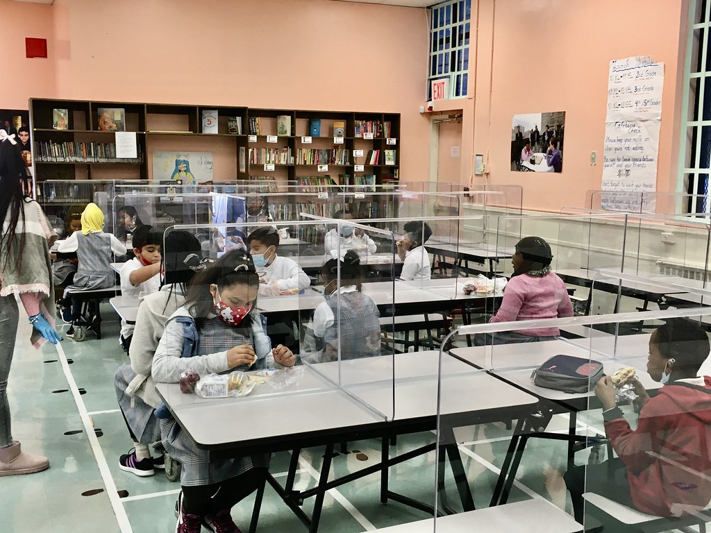 Cafeteria tables with students