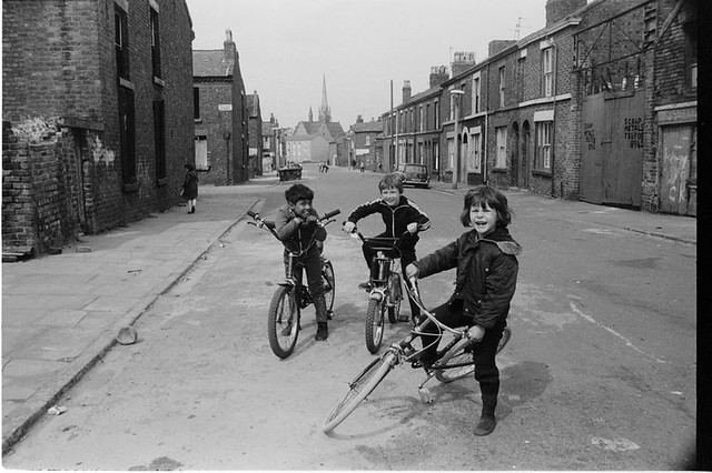 Three lads on bikes, Maud and Elaine Street, Liverpool 8 photo by Ian Clegg, 1979 from @angiesliverpool on Twitter