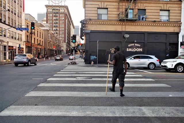 Man Walking Across Los Angeles St.
