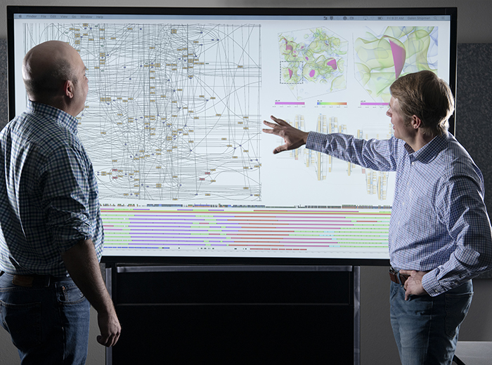 Computer scientists Pat McCormick (left) and Galen Shipman inspect a task graph for a supercomputing application.