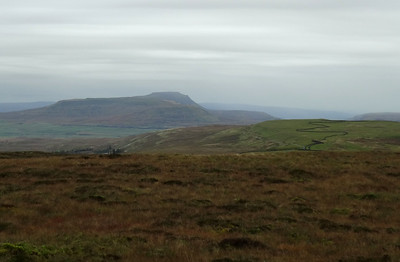 The distinctive silhouette of Ingleborough from the slopes of Dodd Fell