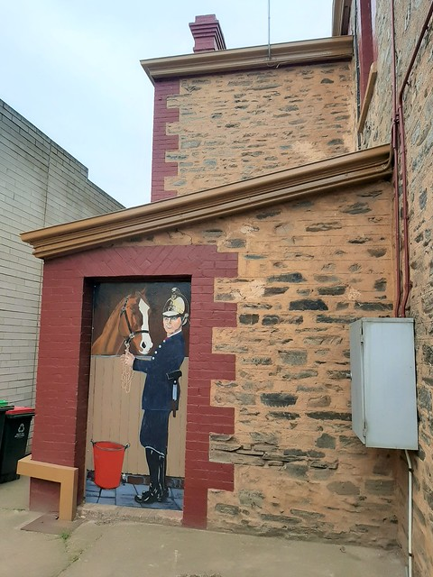 Kapunda. Naive painting of a fireman on the wall of the old Kapunda Fire Station.