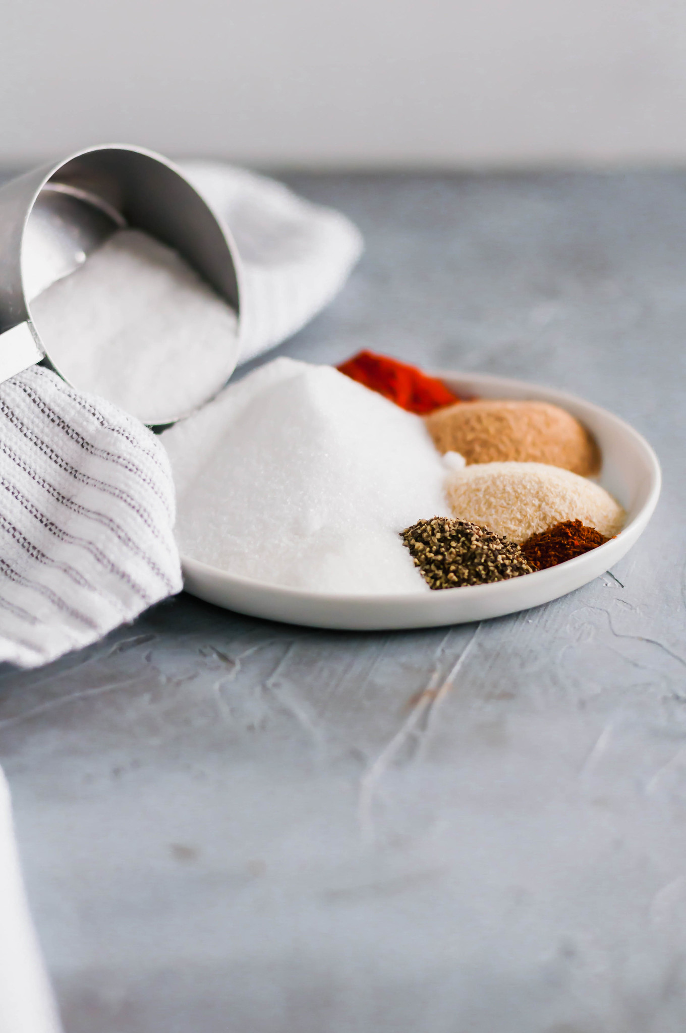 Skip the store-bought stuff and make your own Homemade Seasoned Salt. Mix it up in minutes with ingredients already in your cabinet.