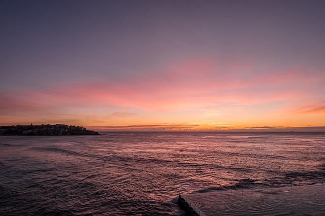 Light clouds at dawn off Sydney's Icebergs ocean pool at Bondi.