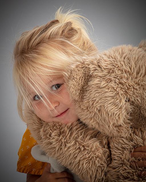 G hugs her bear