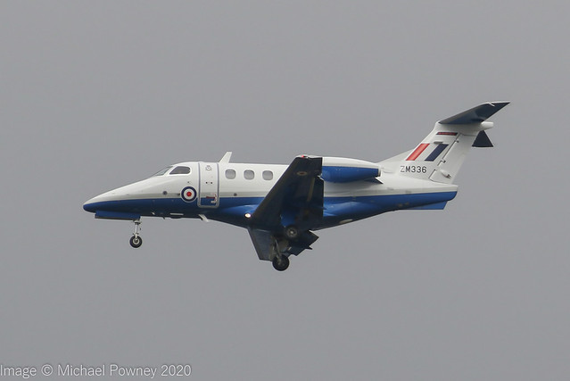 ZM336 - 2017 build Embraer 500 Phenom 100, performing a training approach to Runway 23R at Manchester against a backdrop of very grey skies