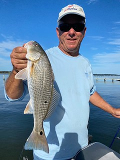 Photo of man holding a red drum