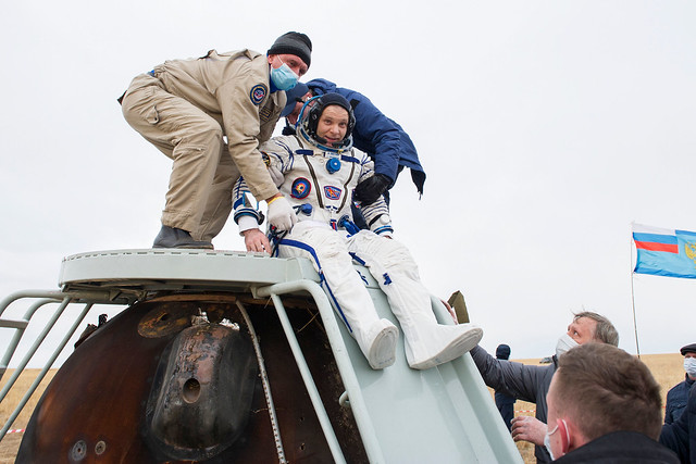 Cosmonaut Ivan Vagner is helped out of the Soyuz MS-16 spacecraft